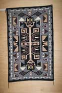Teec Nos Pos Navajo Weaving with Feathers by Connie Yabeny