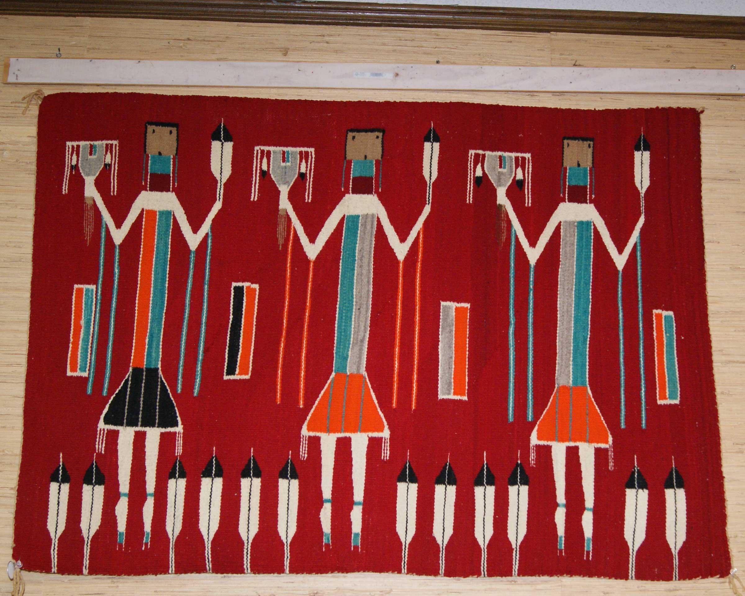 Three Female Navajo Yei Weaving On A