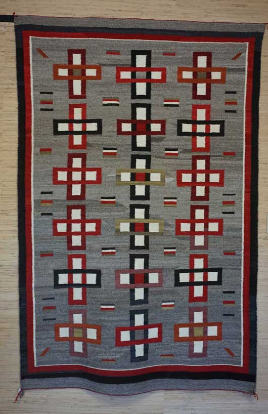 Ganado Navajo Rug Weaving with Three Columns of Eight Crosses in the Three Column Format