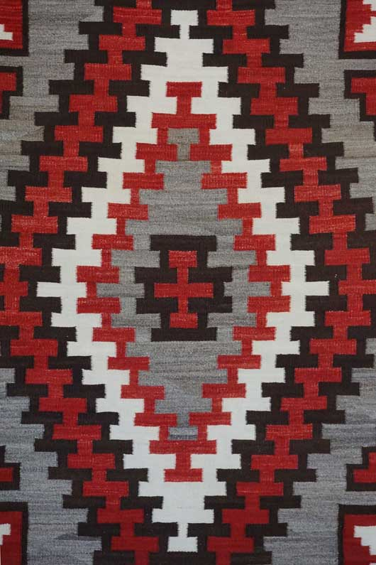 Large Ganado Single Diamond Format Navajo Weaving with Two Blocked Hourglass Figures in Each Corner 936